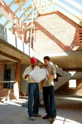 Two contractors in Basking Ridge, NJ planning work on home additions.